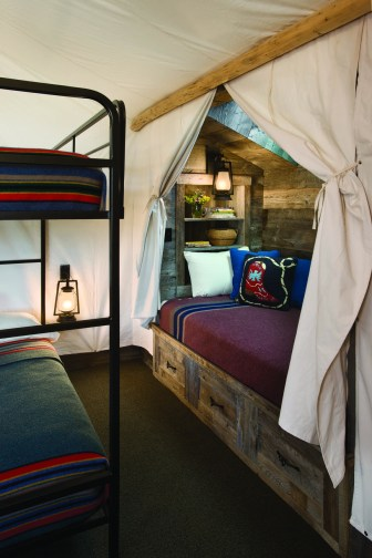"The ""tent"" room with canvas draping, Pendleton blankets, and full-sized bunk beds, is a family favorite."