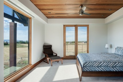 Most rooms, including the guest bedroom, offer multiple views of the surrounding mountains.
