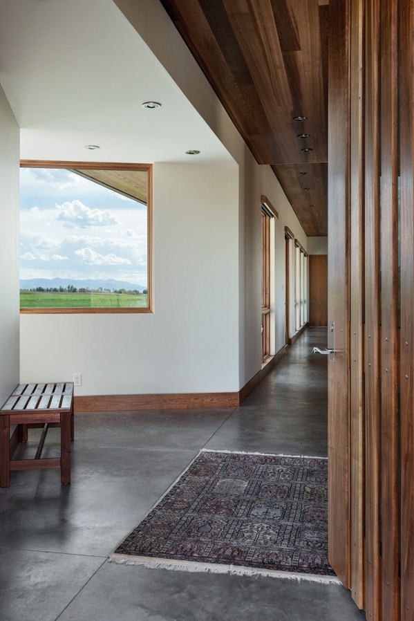 Blake called for radiant floor heating with hydraulic tubing through the concrete floors so his clients could walk barefoot through the home year round.