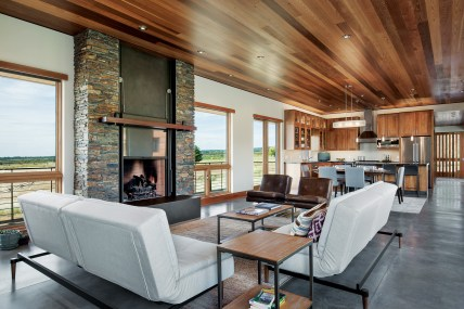 The open floor plan complements the spacious views from almost every window. opposite: The home is clad in COR-TEN steel that patinas to a color matching nearby weathered wood homes.