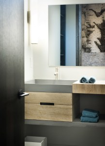 The contemporary theme continues through into the smallest details, including the clean lines of the sinks.