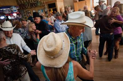 Toby Thompson's dance partner Nancy Milligan of Livingston two-steps with a cowboy in her turquios vaquera dress.