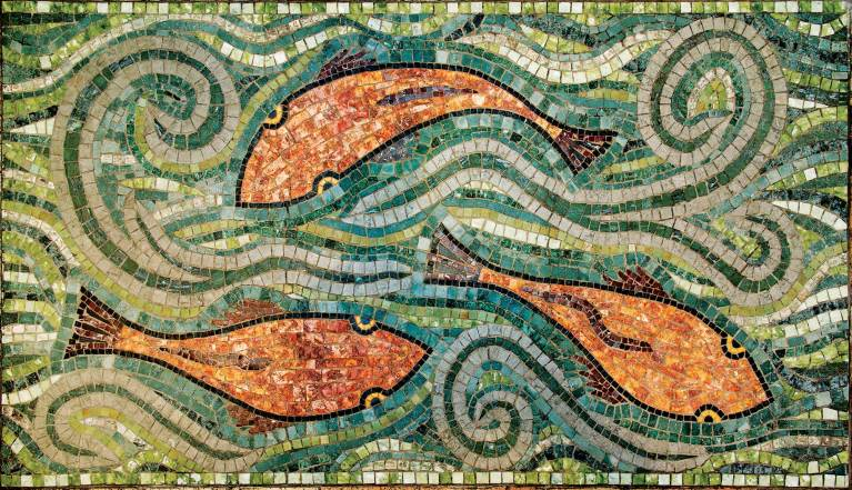 She installed a mosaic of swimming fish into the ladies' room at Plonk in Bozeman.