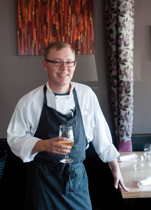 "Lilac chef and proprietor Jeremy Engebretson takes a break from the kitchen to sip on a local brew. ""Local, sustainable and approachable"" are the terms that define his cuisine."