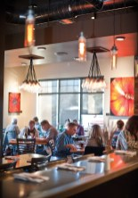 The dining room is always energized after 5 p.m. All of the restaurant's artwork is by Stimpson's 20-year-old cousin Chance Robinson. These are acrylic paintings on canvas