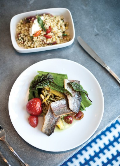 Montana trout, zucchini spaghetti, carrot-top pesto, and roasted tomatoes are accompanied by an Israeli couscous with roasted vegetables and crème fraiche.