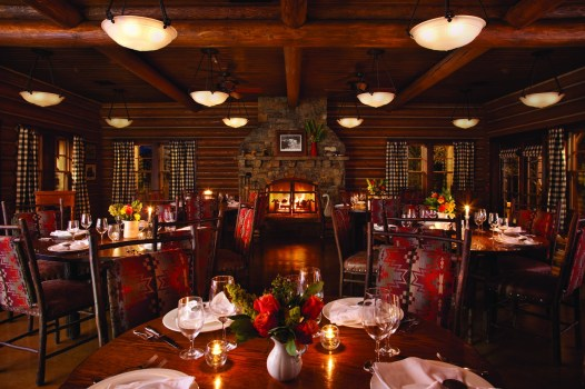 The main dining room inside the Granite Lodge at The Ranch at Rock Creek exudes rustic elegance. With interior design by Jet Zarkadas, owner of the Santa Fe-based firm, Los Griegos Studio, the charm of reclaimed wood and logs paired with Pendleton blanket-inspired upholstery and a cozy fire, the room is welcoming and authentically Western.