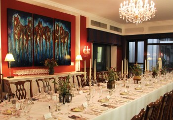 """In the formal dining room of the American ambassador's residence in Beijing, Billings artist Carol Spielman's 6-by-9-foot tryptych, """"Welcoming Committee,"""" greets prestigious guests from all over the world."""