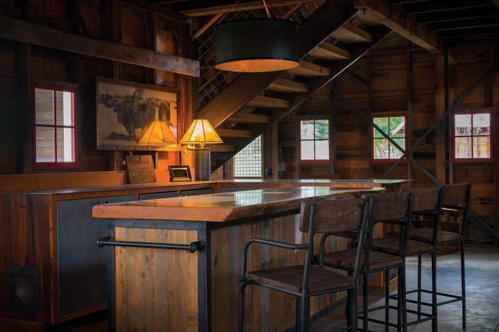 The barn features a bar and a patio on the second floor that looks out to the farmland and mountains.
