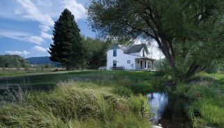 A creek runs by the farmhouse, which was kept to the same square footage as the original 1906 design.