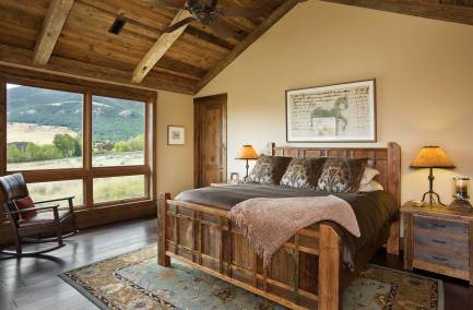 Because the residence was commissioned by two couples, the design required two master suites. This master bedroom, on the house's east end, offers sweeping views of the Absaroka-Beartooth Mountains.