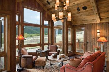 The home's furnishings — a mix of Western and traditional — give it a sense of history and place. As do recycled timbers combined with colors that mirror the surrounding landscape.