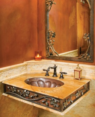 Gilmore's metal branches, leaves, and acorns adorn a sink and mirror.