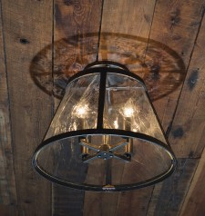 Simple lines by Bar Mill Iron Forge frame the ceiling lights.