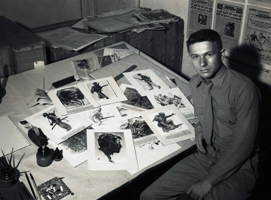 Harry Jackson as a combat artist with his work, 1945.