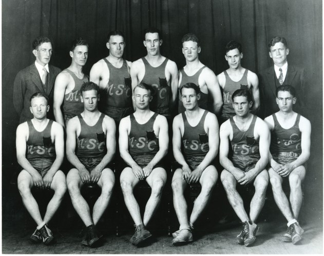 """The fabled 1928-29 Golden Bobcats, one of the greatest teams in the first half of the 20th century. Top row (left to right): Cliff Swanson, Ed Buzzetti, John """"Brick"""" Breeden, Frank Ward, Max Worthington, Harold Saddler and Schubert Dyche (pronounced with a long """"I""""). Bottom row: Fred Browning, Ott Gardner, John """"Cat"""" Thompson, Orland Ward, Peck """"Red"""" McFarland and Roy Homme. Photo courtesy of Montana State University Library"""