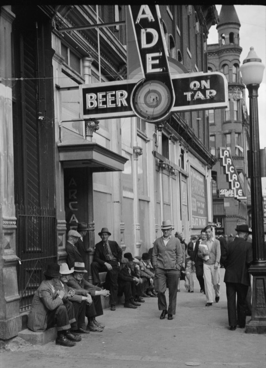Men Lounging in Front of Arcade, Butte, 1939   Photo courtesy of Library of Congress