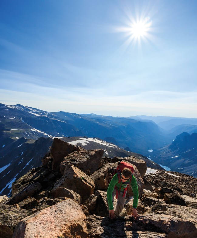 Nathan Zavadil summits Whitetail Peak, Montana's fourth highest peak at 12,556 feet, on a July morning in the Absaroka- Beartooth Wilderness. Photo by Dave Shumway