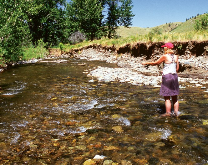 Mary Vandenbosch works the riffles on a hot summer day in Beaver Creek County Park, threading through the Bears Paw Mountains.