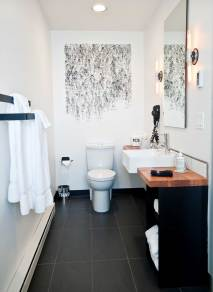 Artist Sukha Worob's original, hand-cast, rubberstamp artwork of human figures in various positions was applied directly to the bathroom wall.