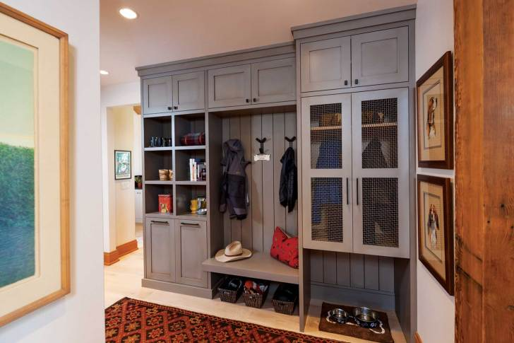 The mud room located off of the front entry does double duty as both hallway and storage space.