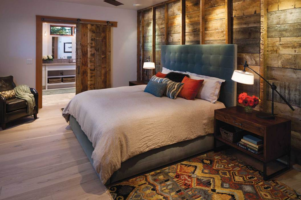By way of paying homage to the former structure, the wood behind the bed in the master bedroom was sourced from the old farmhouse's siding.