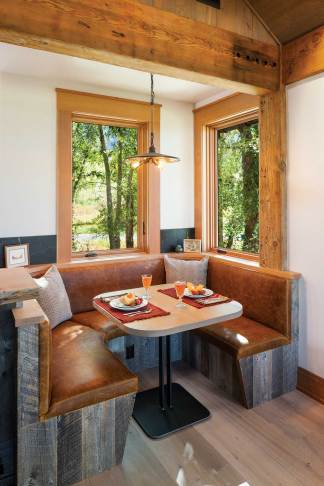 The breakfast nook off the great room provides a cozy sitting area for informal meals or late-night games of Scrabble.