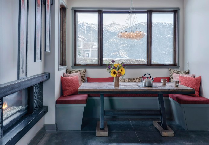 Space-saving and cozy, a kitchen nook overlooking the Spanish Peaks features a table built by the homeowner's brother.