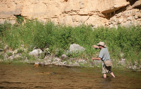 A Smith River angler works his fly through limestone rubble.