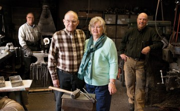 Vic and Ilona Hangas and their two sons, Mark Hangas, right, and Mike Hangas, left, still run Ruana Knives, creating handcrafted knives in the same small shop where Rudy Ruana started the business. They continue to use many of the same methods and tools originally used by Ruana.