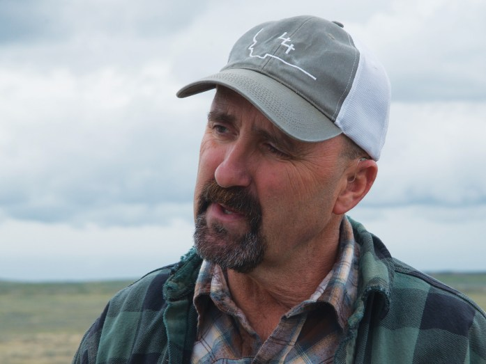 Multi-generation Montana rancher Mike Delaney discusses how he moves his cattle across big country that is home to at least 10 sage grouse leks. | Photo by Deborah Richie