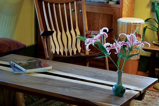A walnut, live-edge coffee table and rocker.