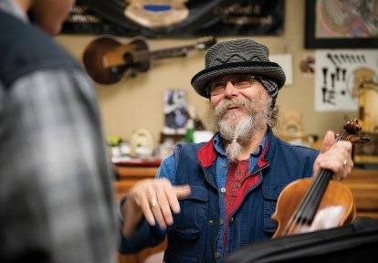 Peter talks with a customer about what he can do to get his violin sounding its best. Peter has been making and fixing instruments since the late 1960s.