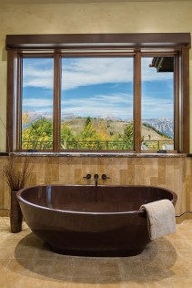 A bronze vessel tub adds sculptural interest to a bathroom that has the feel of a mountain aerie.