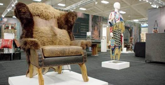 Showcasing a creative blend of handmade home furnishings and fashion, the 2015 Western Design Conference in Jackson, Wyoming, included the Buffalo Collection club chair and a contemporary interpretation of an elk tooth Native American dress by Sandra Okuma. Photo by New Thought Media