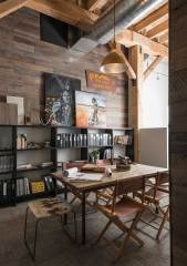 Reconfiguring a space that was once a pea cannery, Miller Architects preserved the industrial history of the building with open rafters, natural light, and high ceilings.