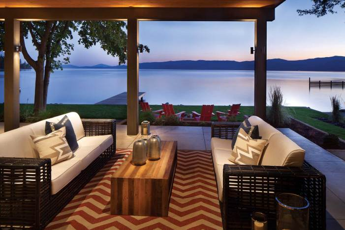 A bold, chevron striped carpet adds a touch of the unexpected to the outdoor living area.