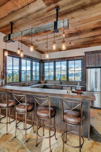 """We took the clients to Four Corners and picked out the reclaimed timber for the custom light fixture above the ski lounge bar, then Blue Ribbon fabricated it with Mason jar-esque lights,"" said Bing."