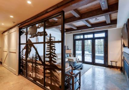 Reid Smith Architects conceived the backsplash behind the ski-tuning table, made of old skis sourced from local ski bums. It was fabricated by Blue Ribbon.