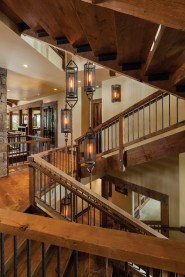 A custom-designed light fixture spans the length of the home's three floors.