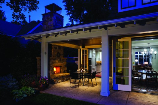 A covered outdoor fireplace located off the kitchen and adjacent from the dining room, ensures that the outdoors are enjoyed year round.