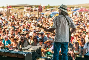 James McMurtry looks out at the crowd from the stage.
