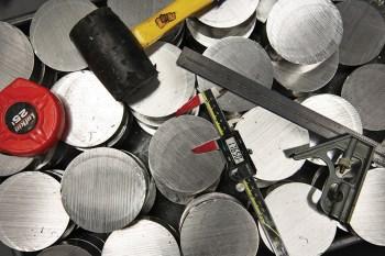 Aluminum pucks await machining.