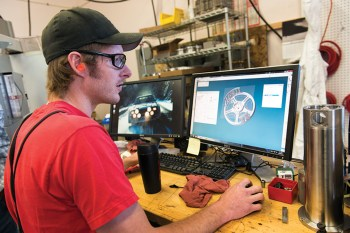 Richie Leibscher works with a computer aided drafting model of the Bozeman Reel.