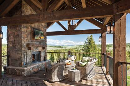 An outdoor patio provides a comfortable space for morning coffee, a shaded retreat for afternoon cocktails, and an unparalleled view.