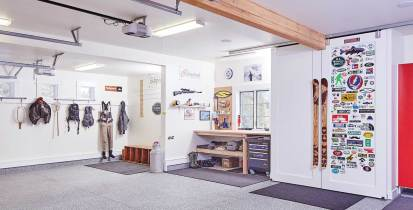 The highly functional garage serves as an organized gear room and workspace.