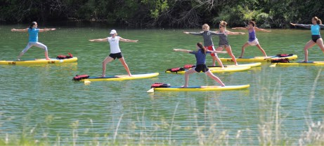 FLOW Outside teaches SUP Yoga among other SUP classes at the East Gallatin Recreation Area. Photo by Rick DuCharme