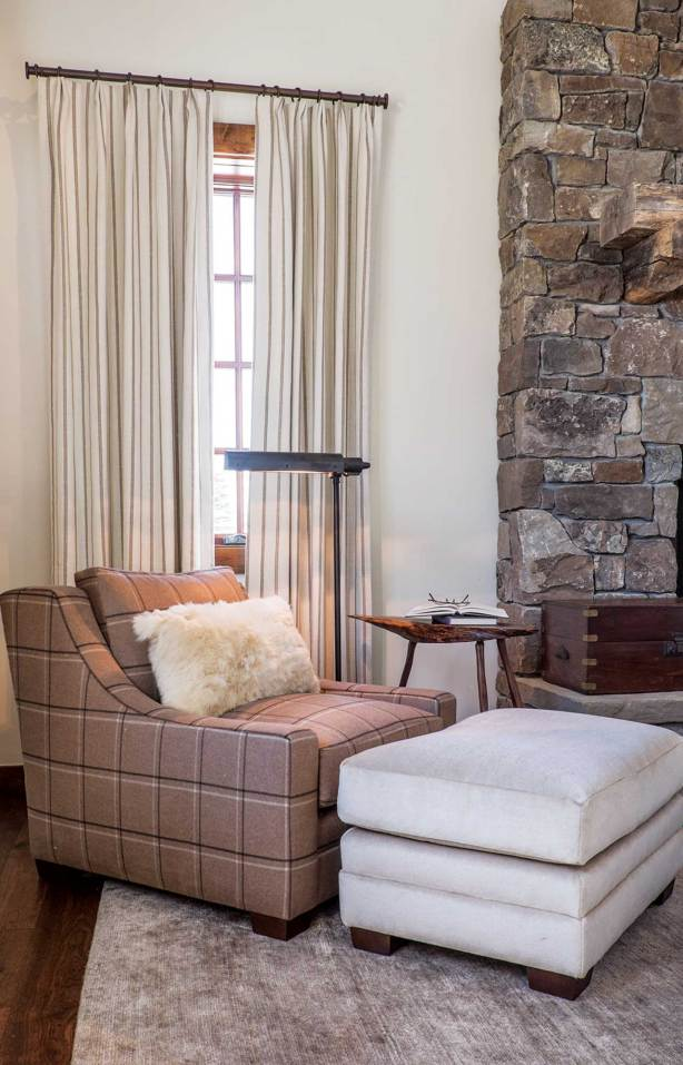 Loro Piana drapes are an elegant backdrop for a plaid Ralph Lauren chair and a mohair upholstered ottoman.