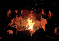 Students discuss their work during a fireside gathering. Photography courtesy Taft-Nicholson Center