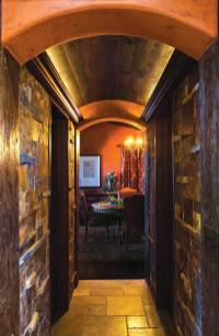 The arched hallway, flanked by pantries, leads from the kitchen to the dining room.
